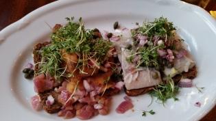 Smørrebrød with fried and pickled herring.